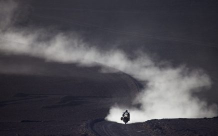 A BMW GS leaves a trail of dust behind it.