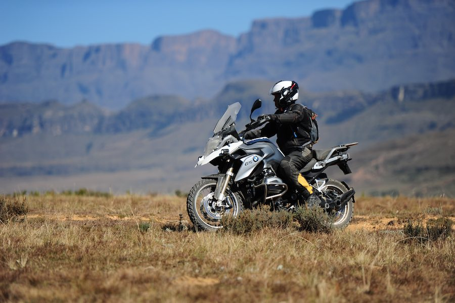 A BMW 1200 GS with the Drakensberg in the background.