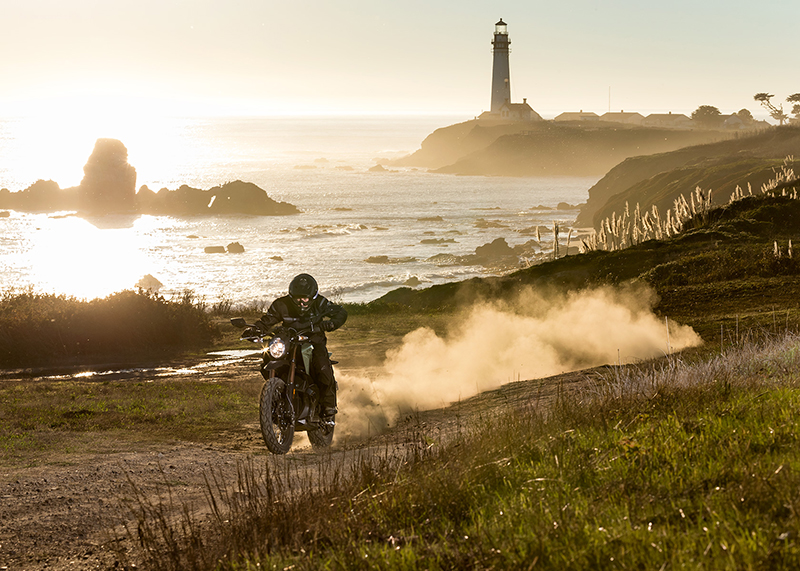A Zero DS ZF 11.4 leaves a dust cloud behind it, with a lighthouse in the background