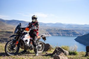The KTM 790 AR and rider, with Katse dam in the background
