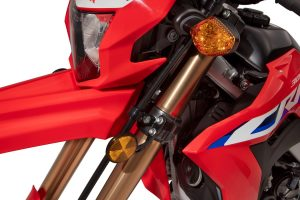 A close-up of the CRF 300 L's headlight and forks