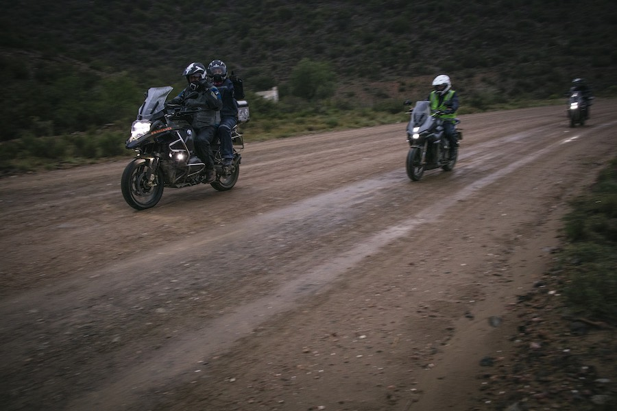 A BMW 1200 GS and a Zontes 310 T on a wet gravel road