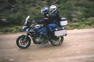 A rider and his pillion on a Zontes 310T fitted with panniers