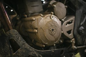 The mud-covered engine of a Zontes 310T