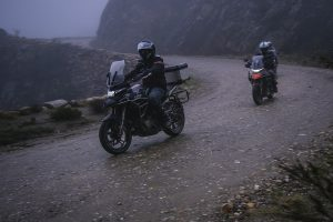 Zontes 310T motorcycles on a dark and misty Swartberg pass