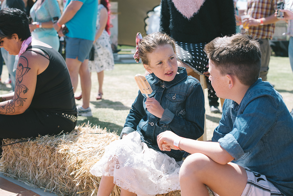 Girl with ice cream talks to boy