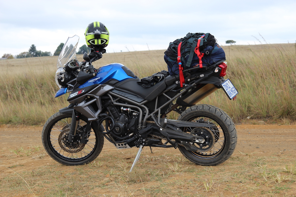 The Triumph Tiger 800 XCx with luggage and helmet