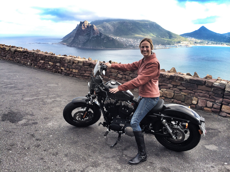 An attractive blonde woman on a Harley-Davidson XL1200X Forty-Eight