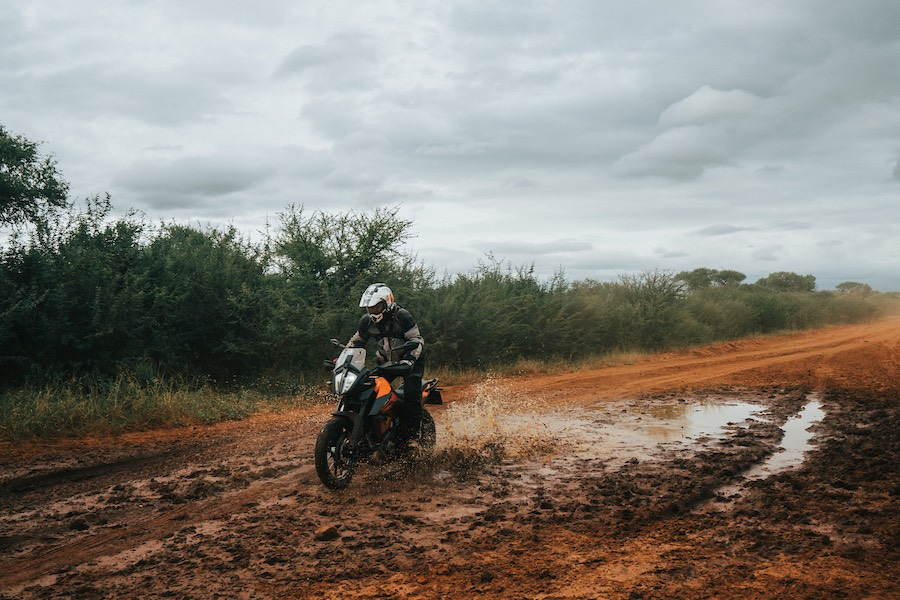 A rider trying to stay upright in the mud.