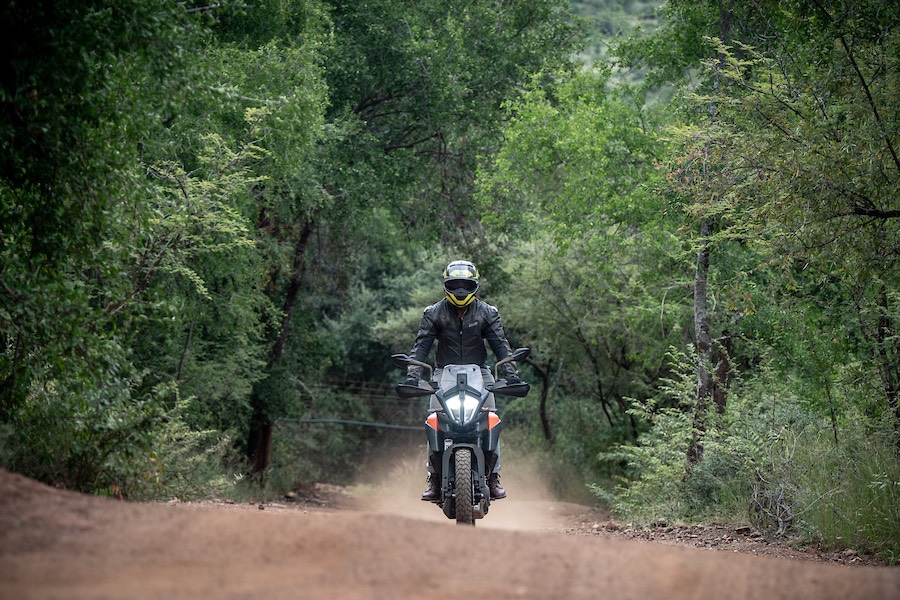 Uzair on the 390 Adventure, riding a forest road.