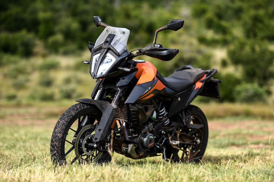 The KTM 390 Adventure, shown at an angle from the front.
