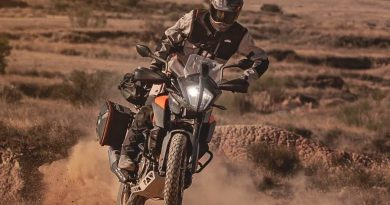 KTM 390 Adventure with luggage riding towards the viewer