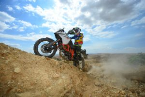 A KTM and rider conquer an obstacle