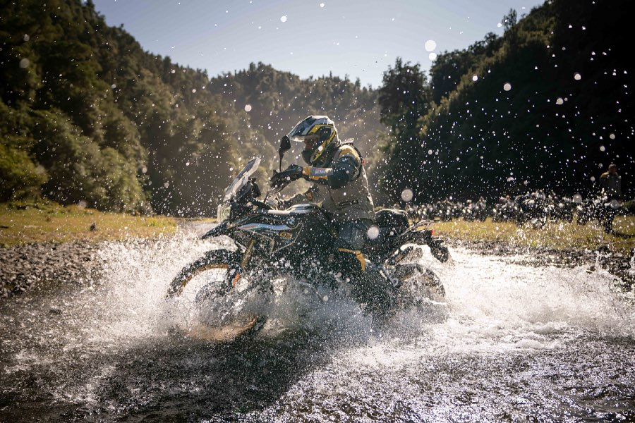 A rider splashes through water at the 2020 International GS Trophy in New Zealand