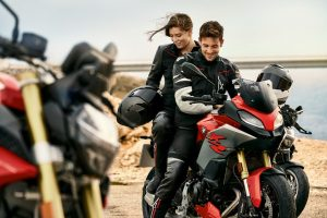 A young, attractive couple on a BMW F 900 XR