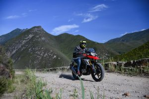 Test-riding the BMW G 310 GS on a smooth gravel road
