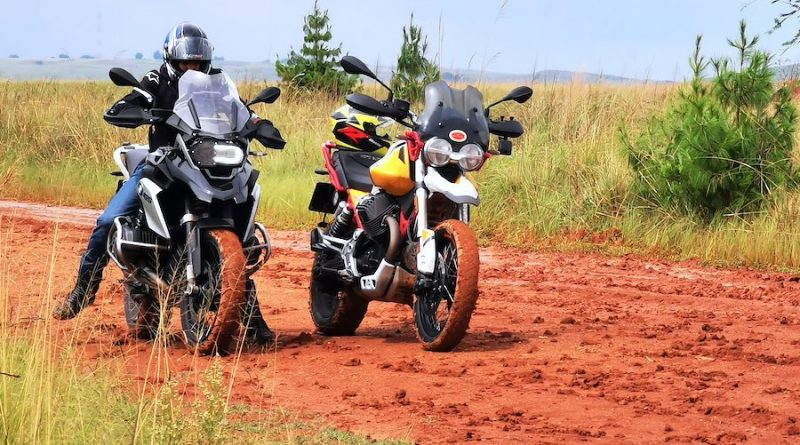 A GS and V85 TT facing on a muddy road