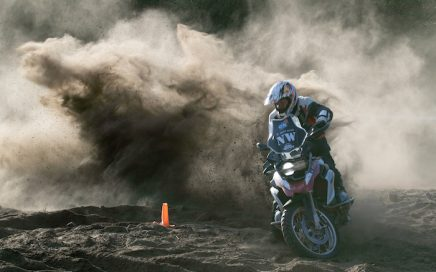 A 1200GS rider shows skill in the soft sand