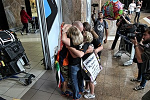 Joey Evans hugs family