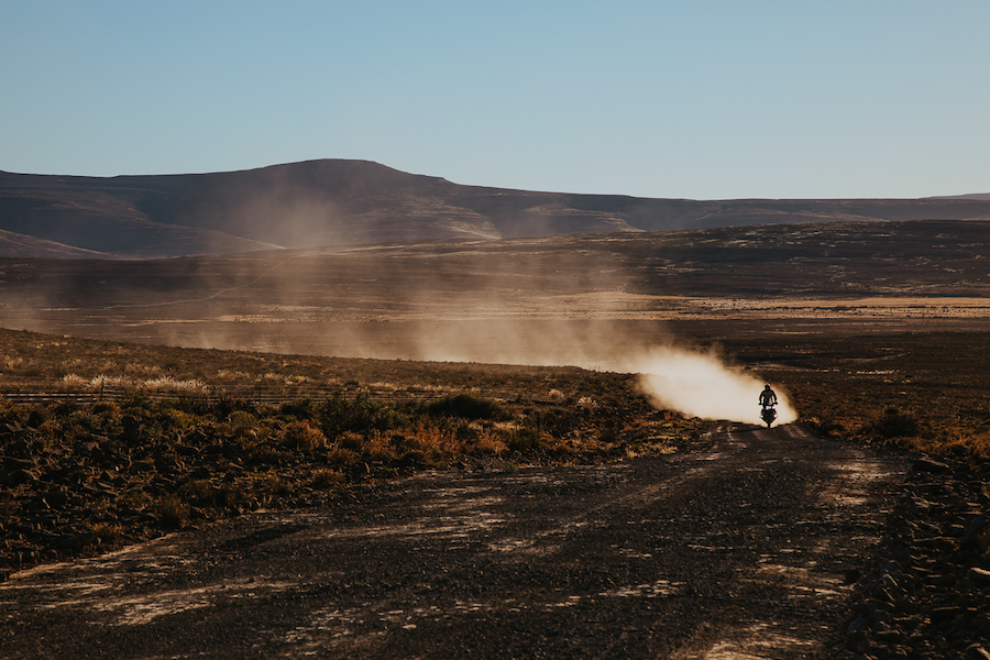 A motorcycle stirring up dust in the Karoo