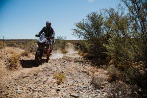A KTM 1190 rider on a gravel road