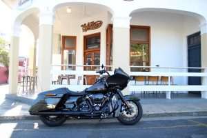 A Harley-Davidson Road Glide Special parked at a café in the Strand