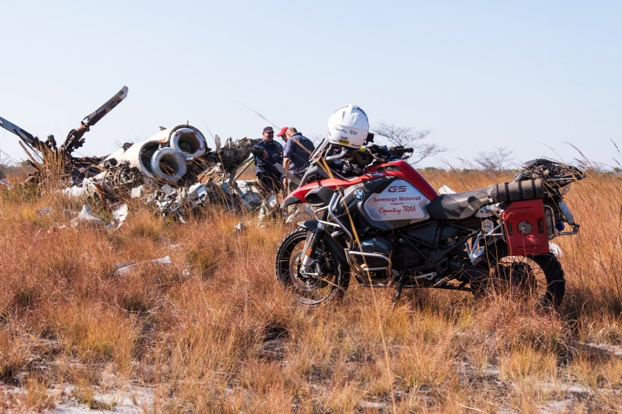 A BMW boxer GS and the carcass of a Russian attack chopper